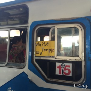 depart bus with White Temple sign